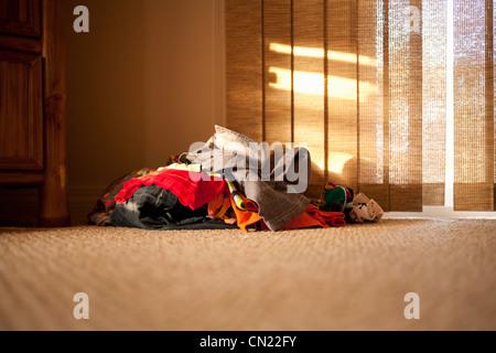Pile of clothes on floor - Stock-Bilder