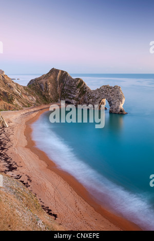 Deserted beach at twilight, Durdle Door, Dorset, England. Winter (January) 2011. - Stock-Bilder