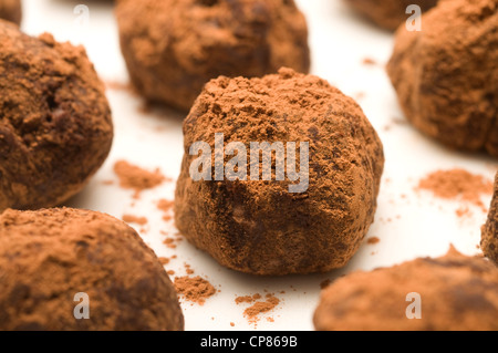 Handmade chocolate truffles in cocoa powder - Stock Image