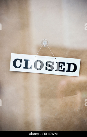 Closed sign on a shop door - Stock Image