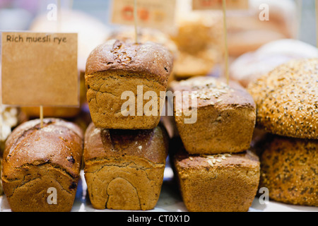 Stacks of fresh bread for sale - Stock-Bilder