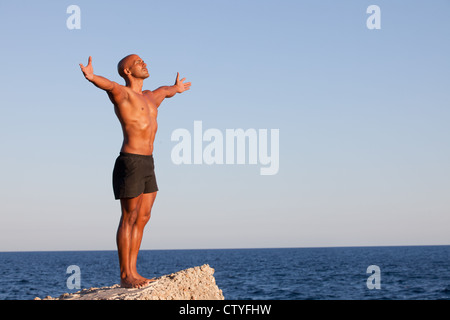 summer man with arms outstretched on vacation - Stock-Bilder