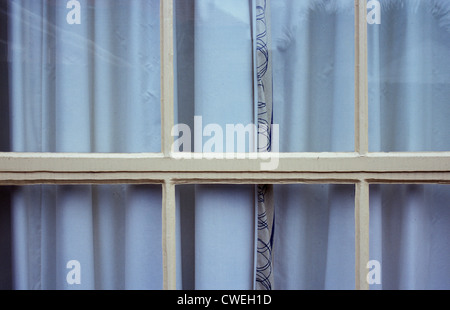 Detail Of Smart Window Divided Into Small Panes With Lined Curtains Drawn  And Small Strip Of