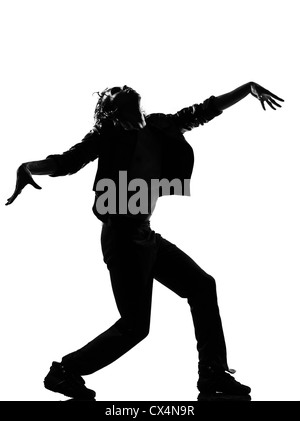 full length silhouette of a young man dancer dancing funky hip hop r&b zombie walk on  isolated  studio white - Stock Image