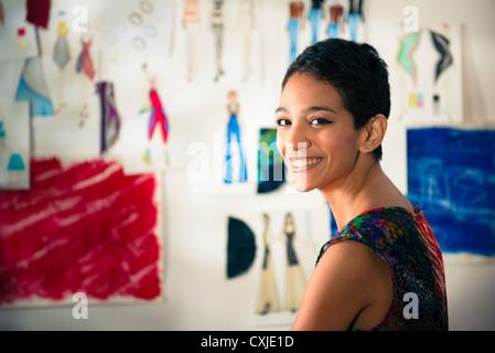 Confident entrepreneur, portrait of happy hispanic young woman working as fashion designer and dressmaker in atelier - Stock-Bilder