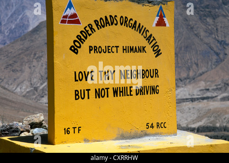 Stone sign, poetic invitation to drive carefully, Nubra Valley, Ladakh, Indian Himalayas, Jammu and Kashmir, North - Stock Image