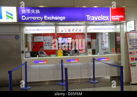 China Shanghai Pudong International Airport PVG gate area concourse terminal currency exchange Travelex front window - Stock Image
