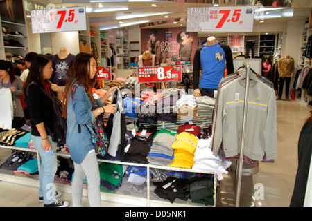 Shanghai China Huangpu District East Nanjing Road shopping Jeanswest Jeans West clothing fashion Asian teen girl - Stock Image
