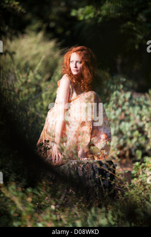 Dreamy image of a girl in the woods - Stock-Bilder