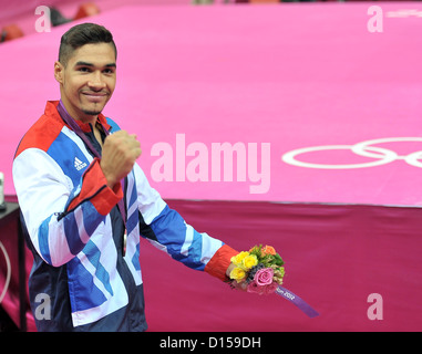 Louis Smith (GBR, Great Britain) punches the air after getting his silver medal. Individual Gymnastics - Stock Image