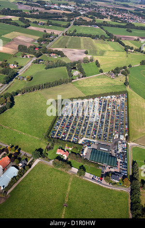 The Netherlands, near Almelo, Car scrap yard, surrounded by farms and farmland. Aerial. - Stock Image