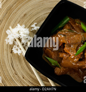 Close up of bowl of beef with vegetables - Stock Image