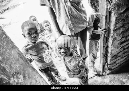 A group of Uganda children on a small family farm - Stock Image