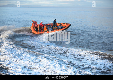 Rescue boat training in open water - Stock Image