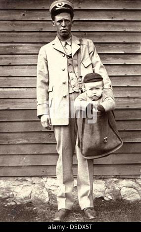 Uniformed Letter Carrier with Child in Mailbag - Stock-Bilder