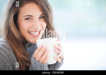Woman with hot drink - Stock-Bilder