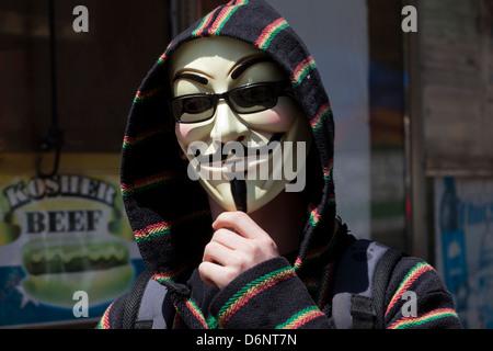 Man wearing Guy Fawkes mask - Stock Image