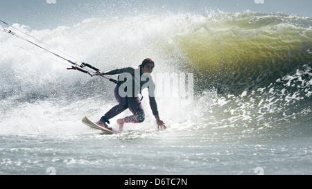 Woman kitesurfing. Tarifa, Costa de la Luz, Cadiz, Andalusia, Spain, Europe. - Stock Image