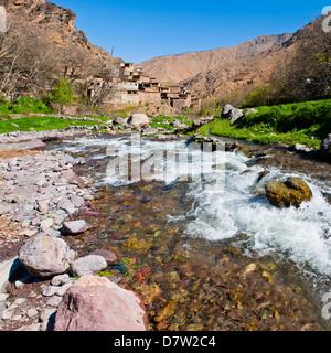 River running past Tizi n Tamatert and a Berber village, High Atlas Mountains, Morocco, North Africa - Stock-Bilder