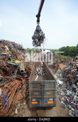 disposal of WEEE waste electronic and electrical equipment being loaded into wagon at processing yard  united kingdom - Stock Image
