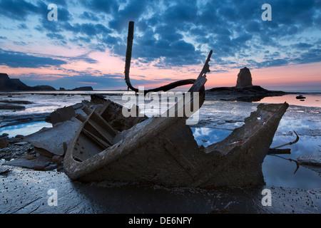 Admiral Van Tromp (aka Admiral Von Tromp) shipwreck Wreckage and Black Nab at Saltwick Bay, Whitby, North Yorkshire, - Stock Image
