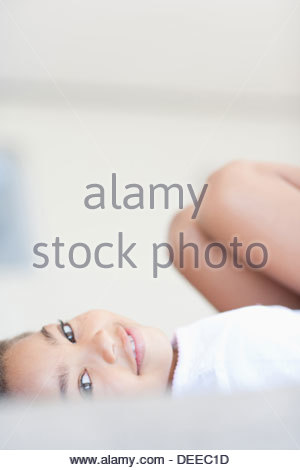 African girl laying on sofa - Stock-Bilder