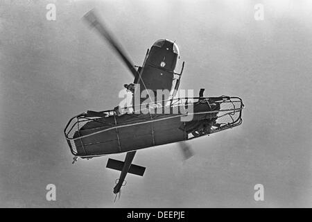 A new mexico air national guard rescue helicopter lifts an injured man in a litter, 1974 - Stock Image