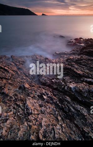 Rocking seascape at dusk in Dartmouth Devon England - Stock-Bilder