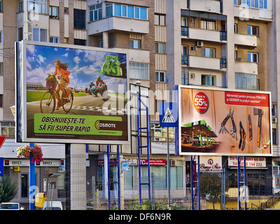 Billboards advertising in front  of new buildings during summer in Craiova, Romaia - Stock Image
