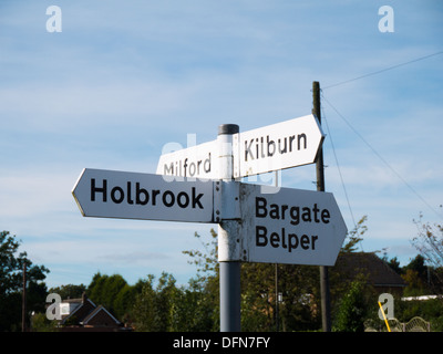 Signpost fo Holbrook and Belper in Derbyshire, United Kingdom. - Stock Image