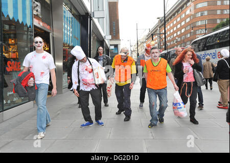 Oxford Street, London, UK. 12th October 2013. Zombies start their walk  through central London. Credit:  Matthew - Stock Image
