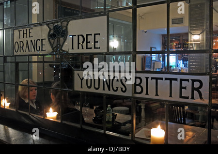 Window stained glass Orange Tree Pub Richmond SW London England UK at night - Stock Image