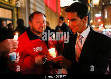 San Francisco, California, USA. 27th Nov, 2013. California State Senator MARK LENO lights a candle preceding a march - Stock Image