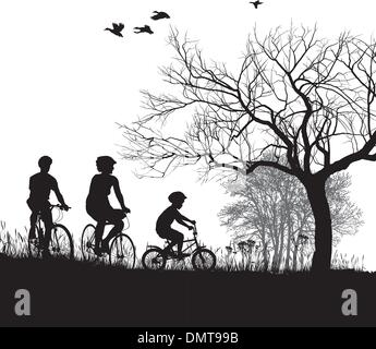 Family cycling in the countryside - Stock-Bilder