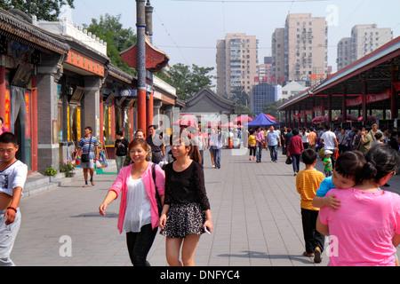 China Beijing Chaoyang District Panjiayuan Weekend Dirt Flea Market shopping selling buying Asian woman - Stock Image