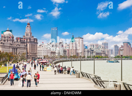 Many people walking along the Bund promenade Shanghai, Peoples Republic of China, PRC, Asia - Stock Image