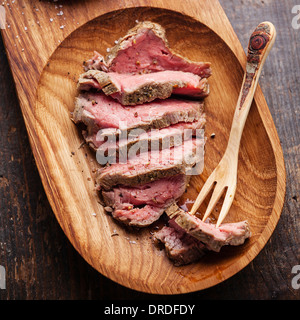 Roast beef and wooden fork - Stock Image