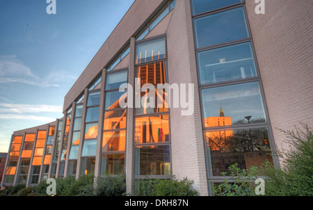 Modern meets 70s Liverpool School of Art and Design with Catholic Metropolitan Cathedral of Christ The King Reflected - Stock Image