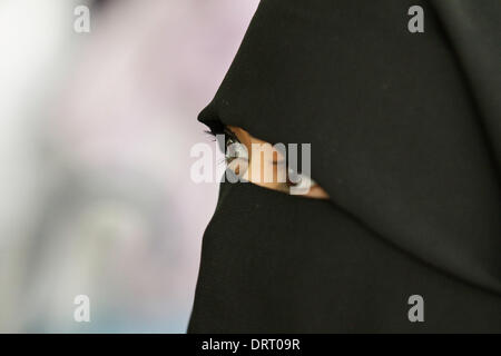 Quezon, Philippines. 1st Feb, 2014. A Muslim woman wearing a full face Hijab attends the World Hijad day program - Stock Image
