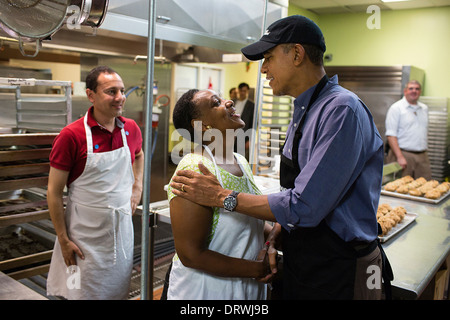 US President Barack Obama greets volunteers at Food & Friends during a service project to commemorate the September - Stock Image