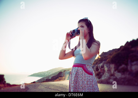Girl taking photographs at dusk, Kas, Turkey - Stock Image