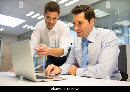 Two handsome businessman working together on a Laptop in the office - Stock-Bilder