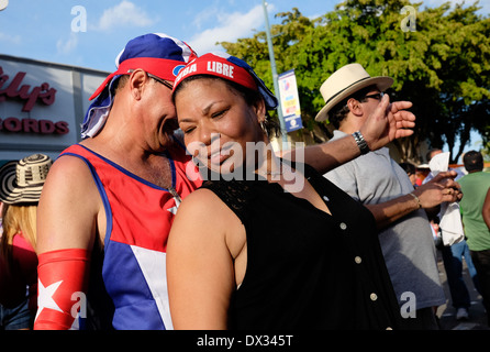 MIAMI - MARCH 9, 2014: People dancing in the streets during the 37th Calle Ocho festival, an annual event that takes - Stock Image