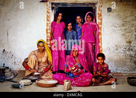 Indian village family in a doorway in a village near Jodhpur, India. Digitally Manipulated Image. - Stock-Bilder