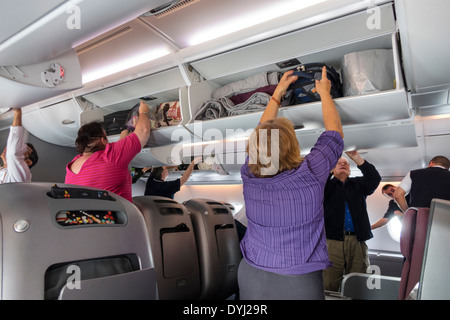 Australia Melbourne Tullamarine Airport MEL Qantas airlines onboard flight cabin business class passengers disembarking - Stock Image