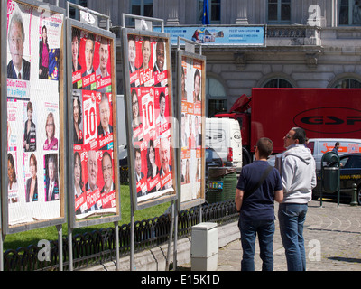Two men looking at European election posters on place Luxembourg square in the EU district of Brussels, Belgium - Stock Image