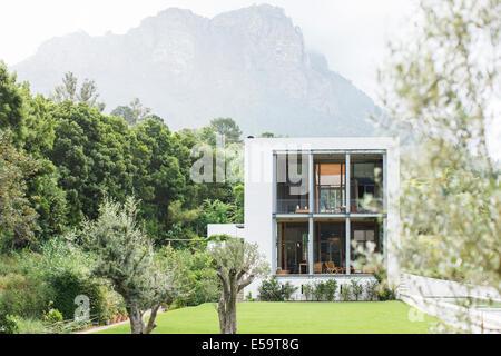 Modern house in rural landscape - Stock-Bilder