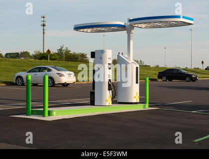 Electric vehicle charging station and parking lot in USA installed by NRG eVGO to recharge electric cars - Stock Image