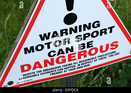 Motor sport is dangerous warning sign at race track. - Stock Image