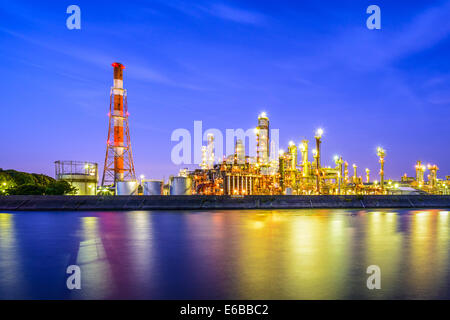 Oil refineries line a river in Yokkaichi, Japan. - Stock Image